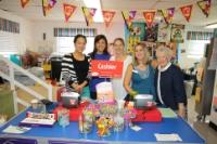 Media Specialist, Caroline Jacobellis with faculty at the Alexander Montessori School book fair