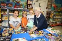 Media Specialist, Caroline Jacobellis with students at the Alexander Montessori School book fair